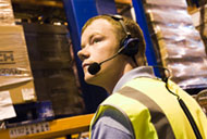 Man wearing a headset in warehouse Voiteq voice solution