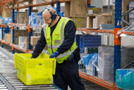 Nisa Warehouse Worker in action using Voice technology